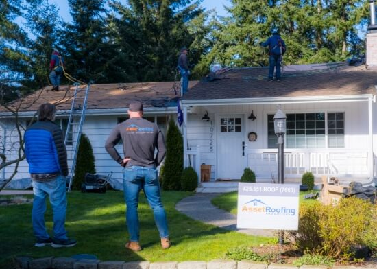 Roofers Working on A Roof Replacement