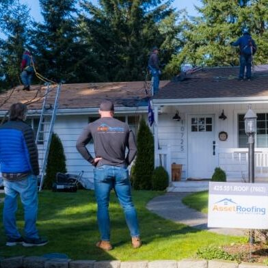 A Roofing Crew Works on a Roof.