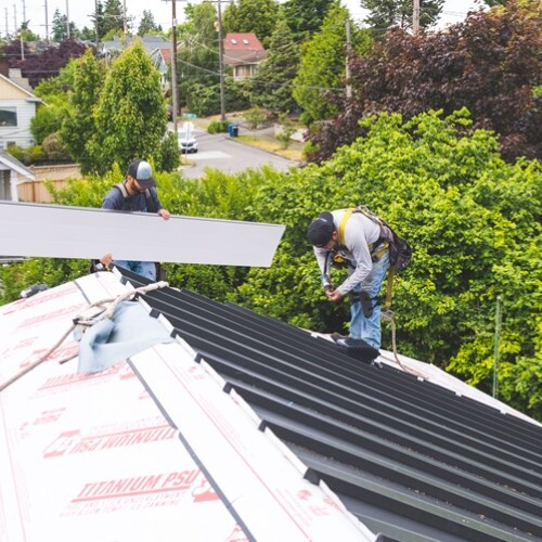 Roofers Install a Standing Seam Metal Roof.