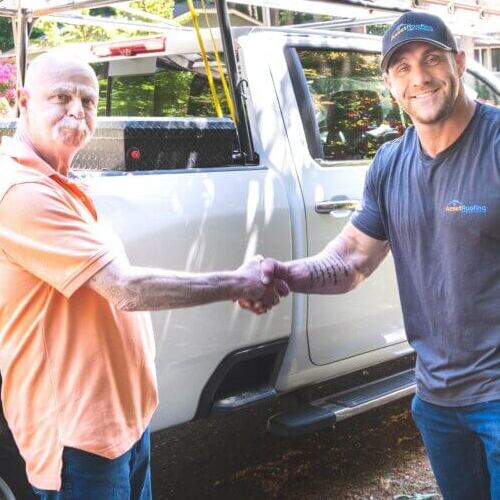 Asset Roofing Shakes Hands With Customer.
