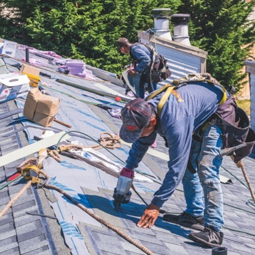 Roofers Repair a Roof.